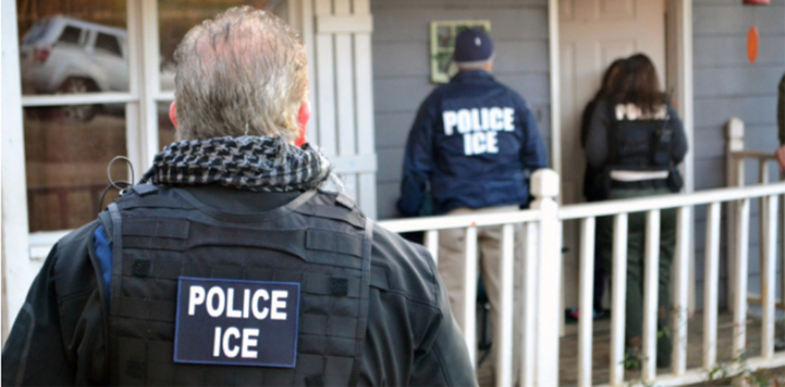 ICE agents at front door of a house