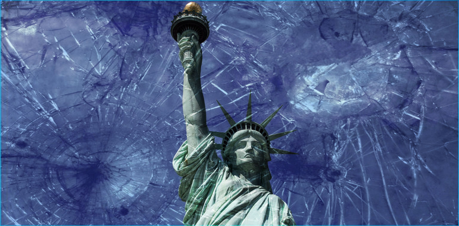 Photo looking up at the statue of liberty with a blue sky in the background and shattered glass in the foreground