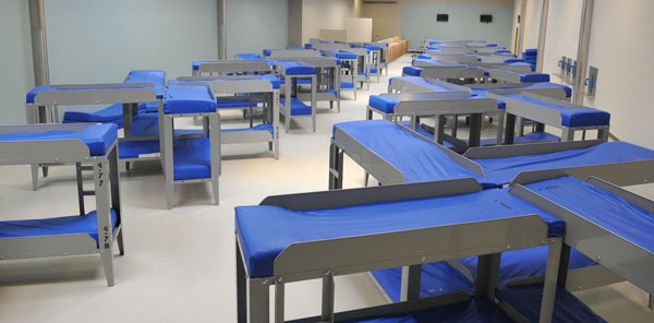 A photo of a dorm with about 80 beds inside ICA-Farmville immigration detention center. Photo credit ICE