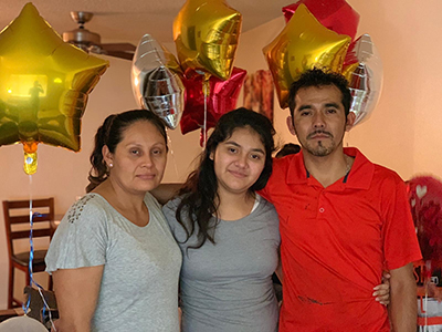 Photo of Margaret's reunion with her family after she was released from detention