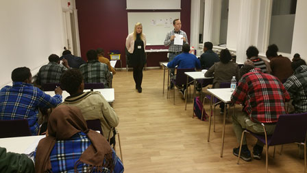 Photo of a briefing for asylum seekers ahead of registration at the Swedish Migration Agency.